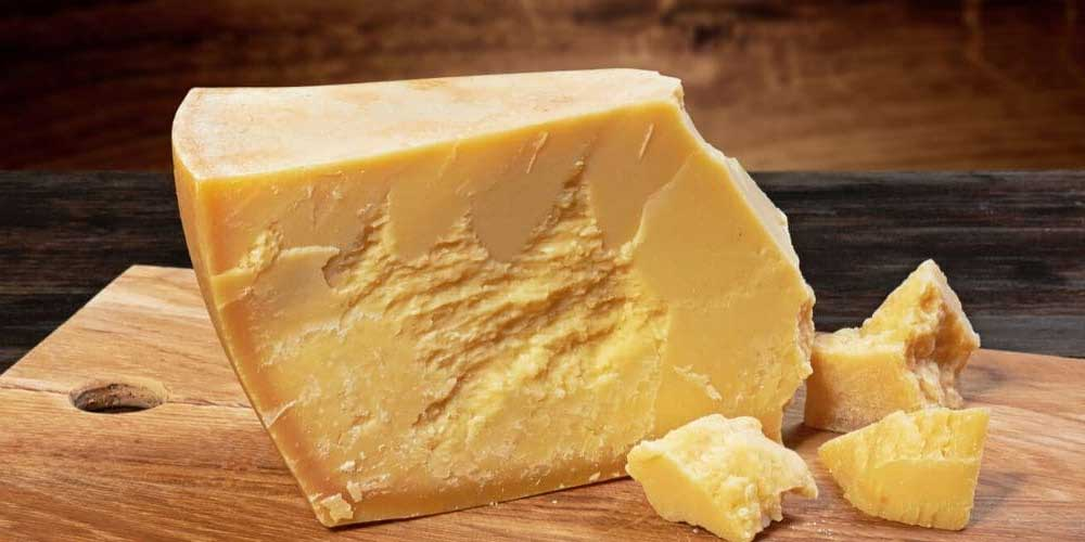 how long is parmesan cheese aged